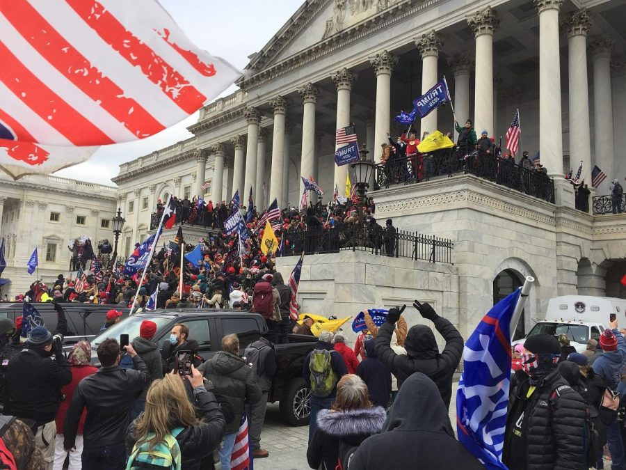 Rioters gather in front of the U.S. Capitol on Jan. 6 in an attempt to overturn the results of the 2020 presidential election. They eventually stormed the building, prompting the National Guard to intervene.