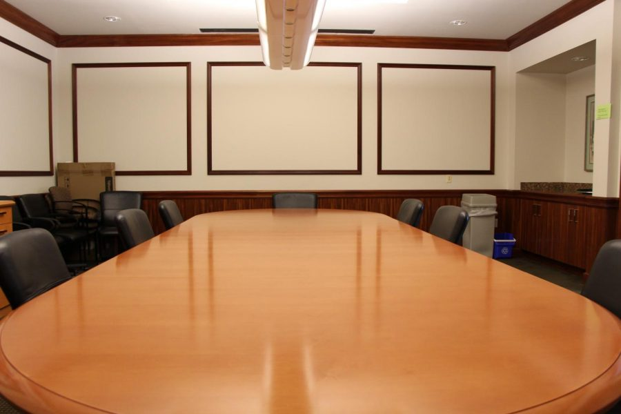 There is enough space around the board room table for student and teacher representatives to join The Benjamin School's Board of Trustees.