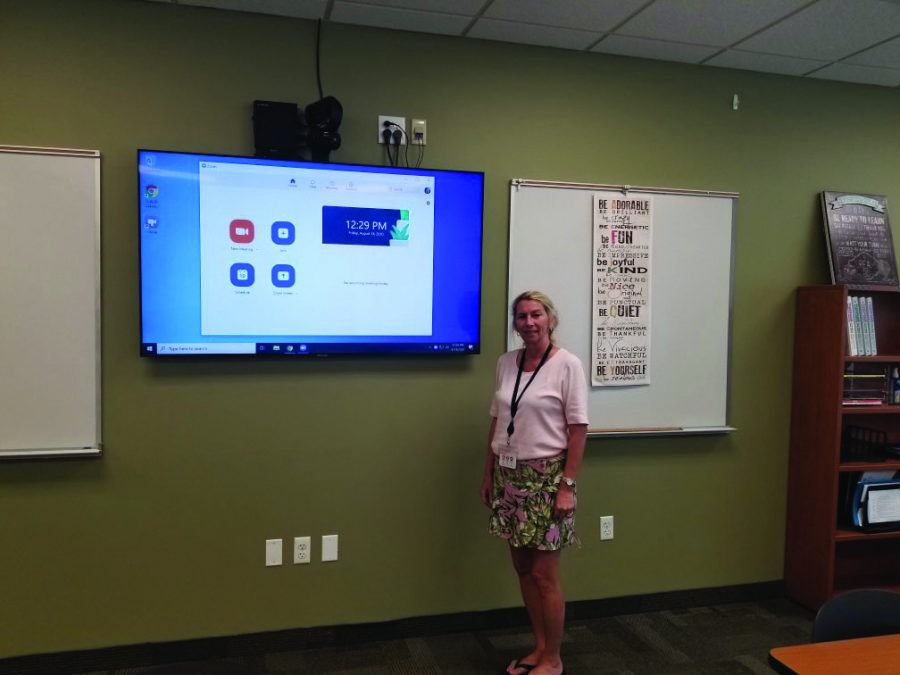 Mrs. Laura Priola stands next to new technology in the classrooms.The School installed a number of new features to make remote learning easier.