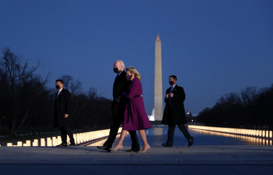 President Joe Biden and his wife Dr. Jill Biden walk together in front of the Washington Monument. The area was transformed into a memorial for the Americans who died during due to the Coronavirus.
