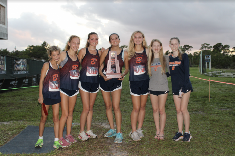 Members of the Cross Country team hold their trophy after finishing first at the District Meet. After qualigying at Regionals, they were able to compete at the State Championship at FSU.
