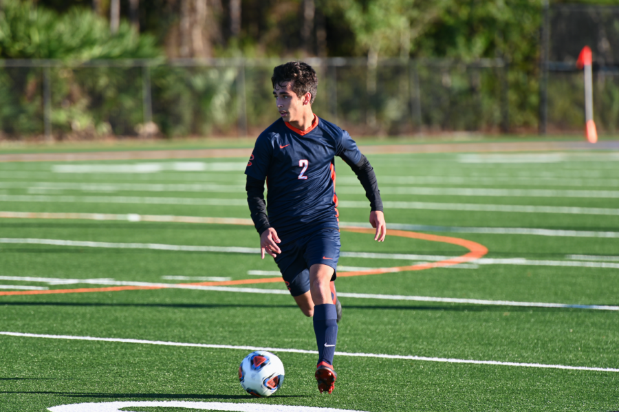 Junior Ryan Hendi looks for an open teammate to pass the ball to during the district semi-finals against Oxbridge Academy.