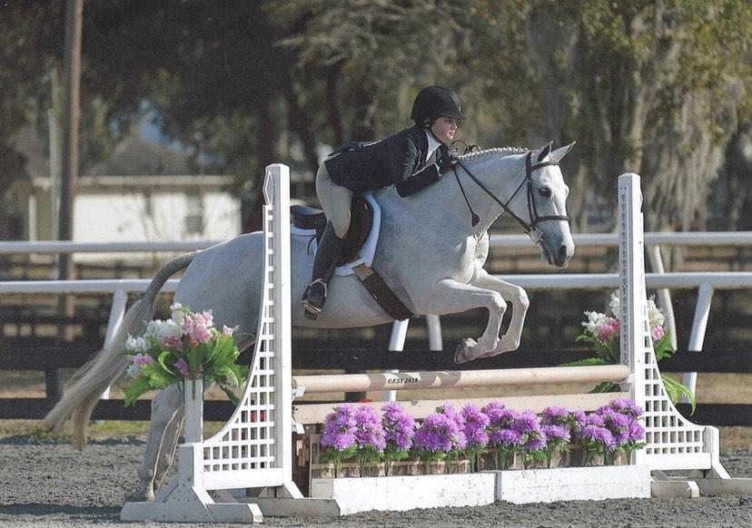 Equestrians Excel: Two Buccaneer Horseback Riders