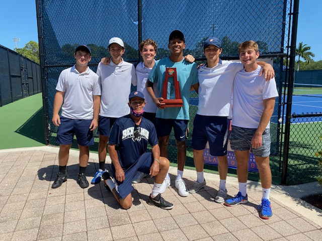 The Varsity Boys Tennis Team holds the District Champion Trophy.
