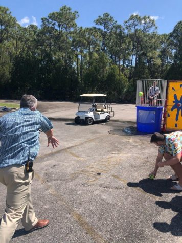 Mr. Carr winds up in attempt at dunking Dean Kevin Jacobsen in the dunk tank.