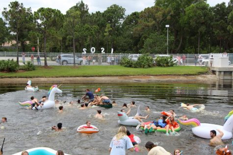 The majority of the Class of 2021 braved the fishy waters of the lake to mark their last day of classes. As is tradition, many chose to bring along inflatables for their float across the pond.