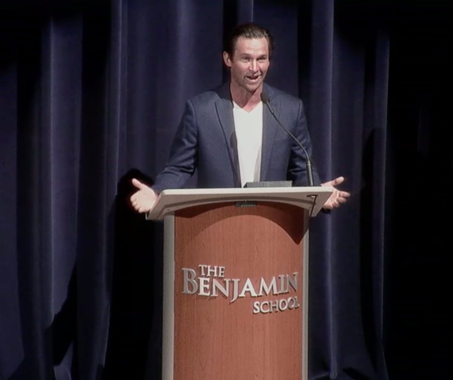 Alumnus of the year, Greg Norman, Jr. '04 addresses a Zoom audience of students, faculty, alumni, family, and friends live from the stage of Benjamin Hall.
