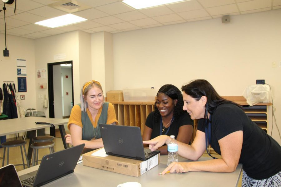 The Arts and Innovation department will look very different this year, as both Mrs. Davis-Rojo and Mrs. Osborne bid goodbye to Benjamin last year. Above, department chair Ms. Ford helps new teachers Ms. Clark and Ms. Duncan navigate some of the technology behind Buclinks.