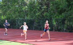 Cross country runners lap the track during August practices.