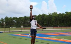 Junior Micah Mays raises the ball to the heavens.