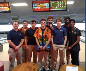 The boys' and girls' bowling teams pose for a team picture during one of their practices. Both teams look to be as successful as possible this year.